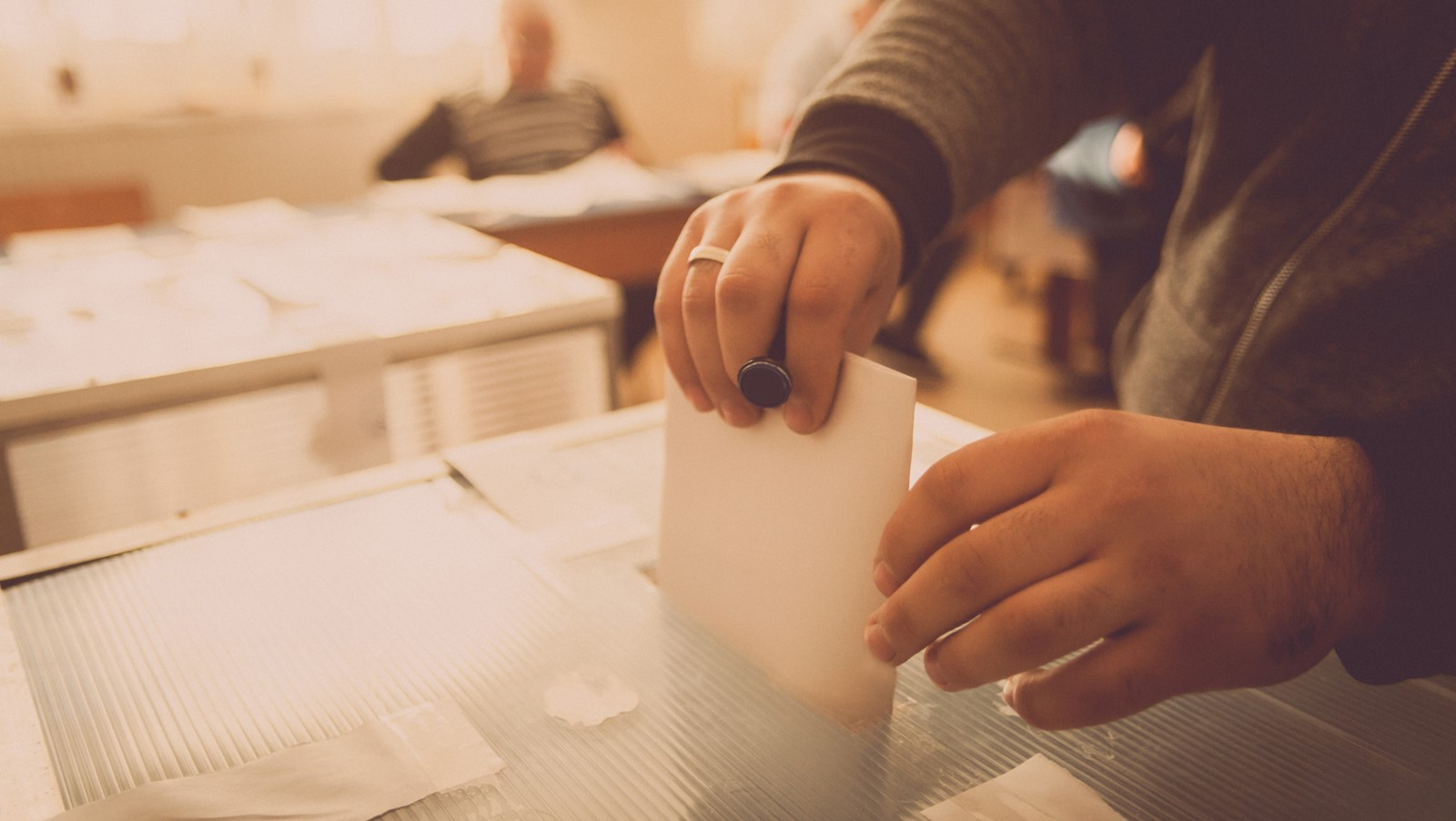 Man posting vote in ballot box